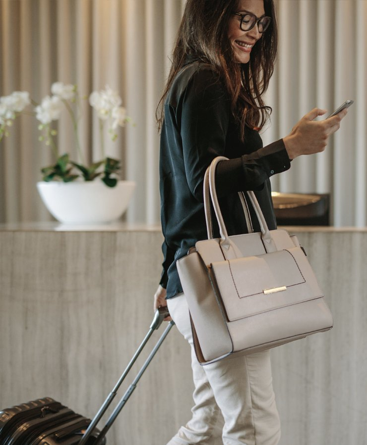 woman with luggage checking into hotel