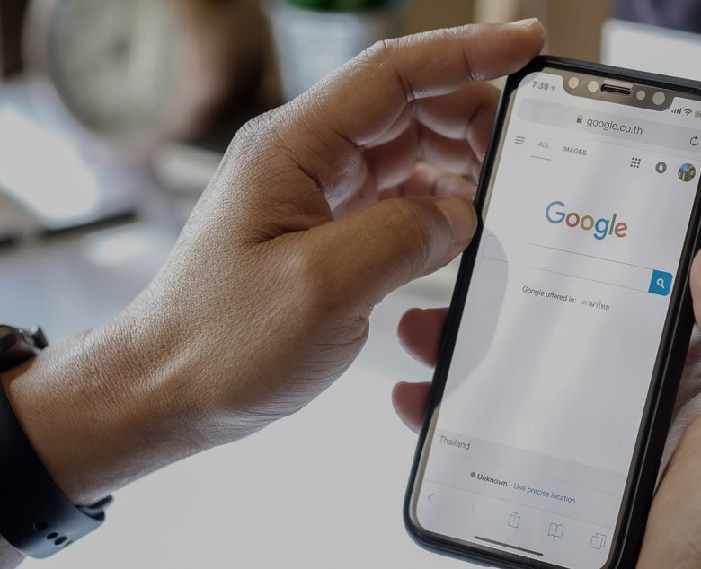 hands holding phone google search