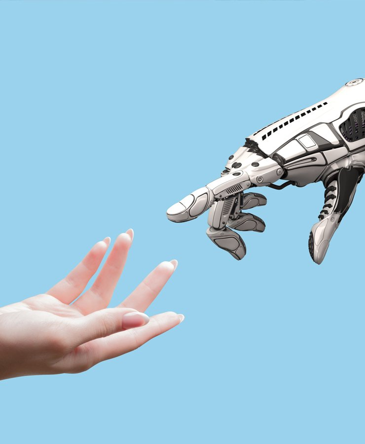 human hand touching robot hand on blue background