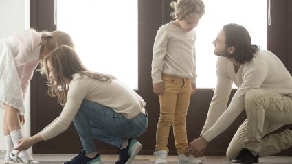 family putting on shoes