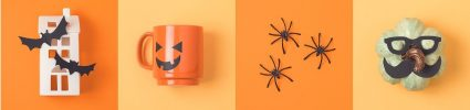 Halloween mug and plastic spiders