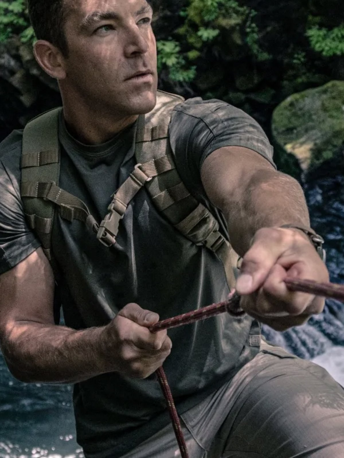 Man outdoors with tactical gear