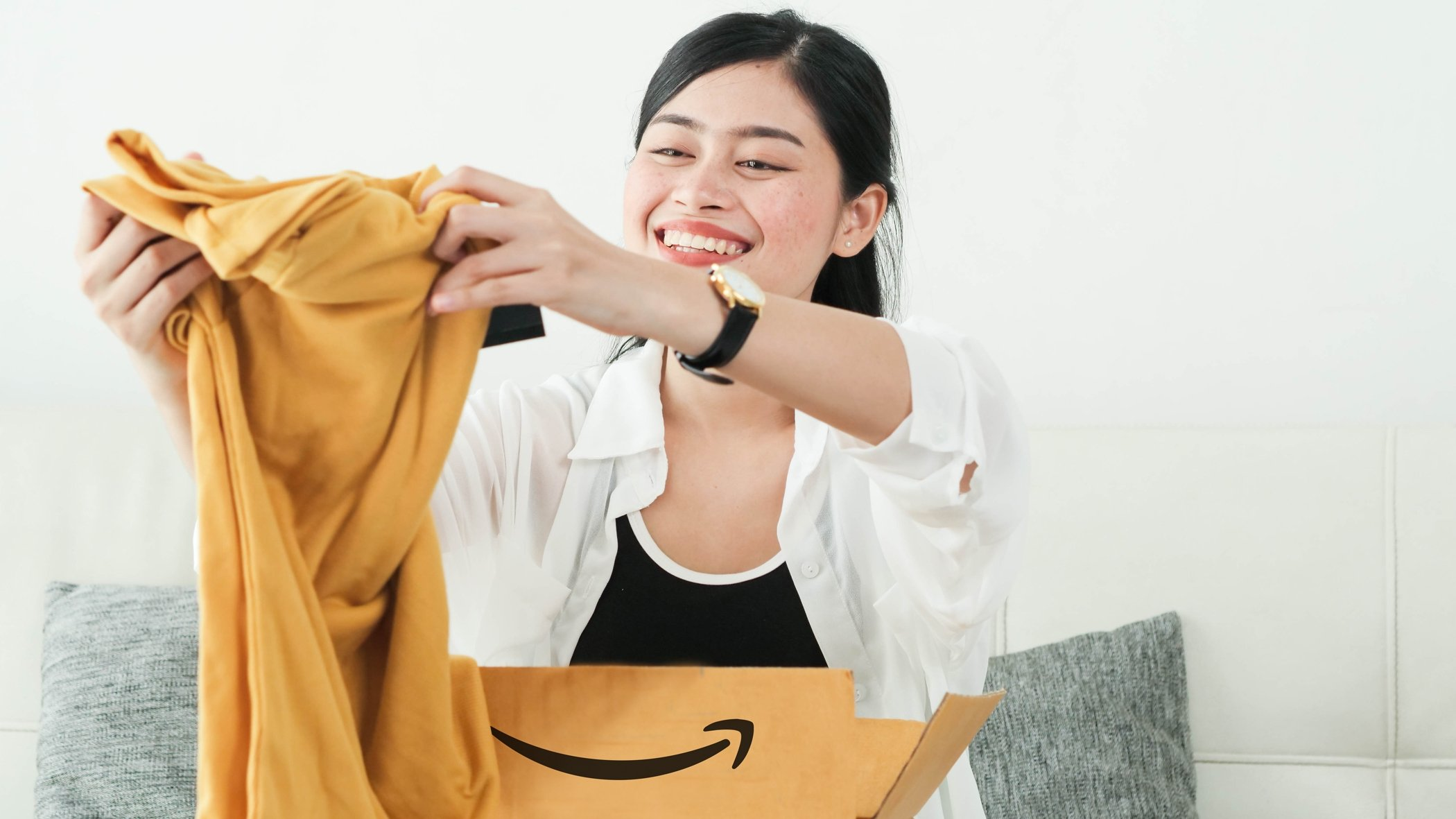 Woman opening Amazon package in her home