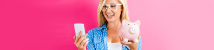 blonde woman holding piggy bank and phone on hot pink background