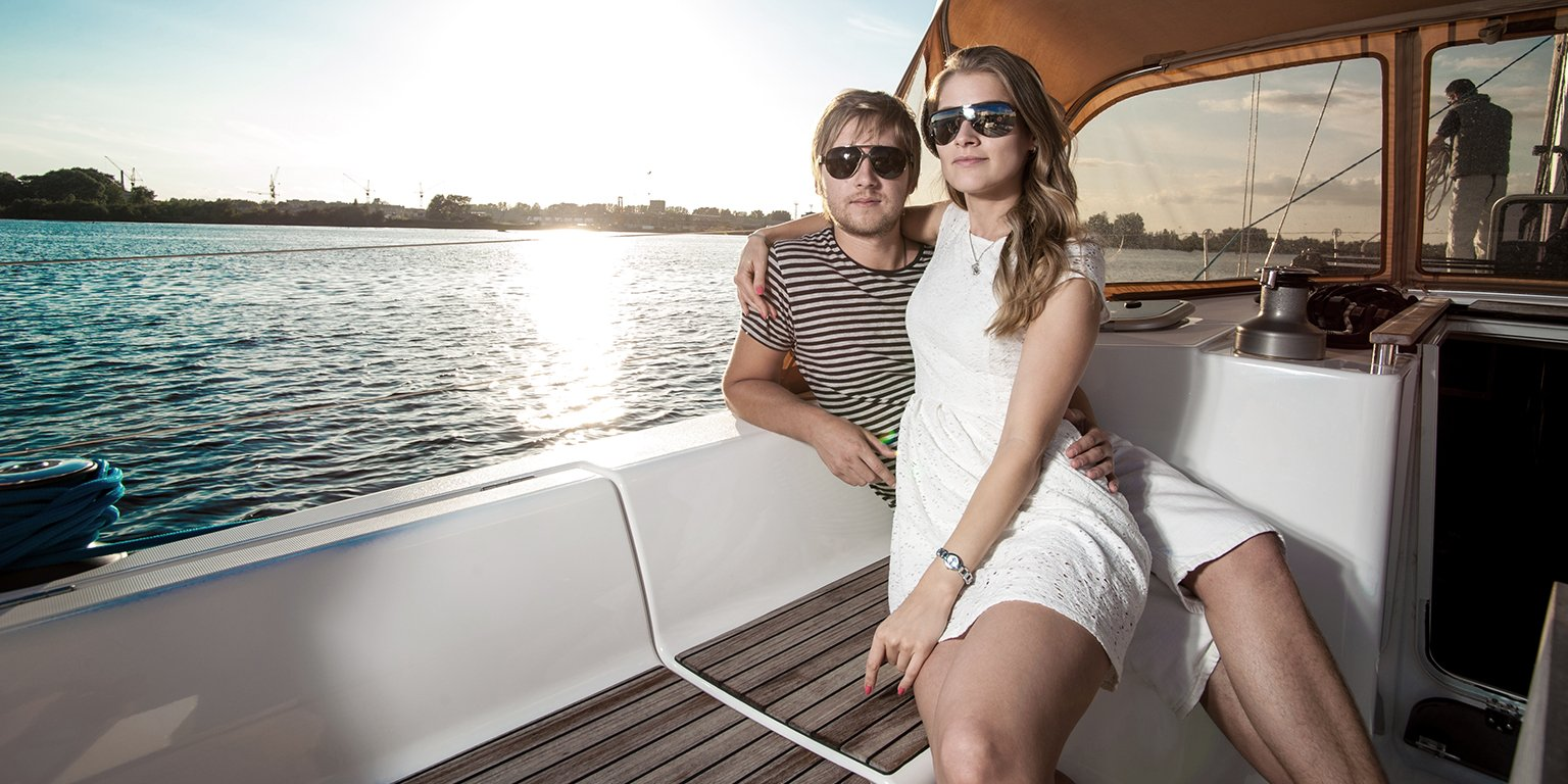 Couple sitting on a boat on the ocean