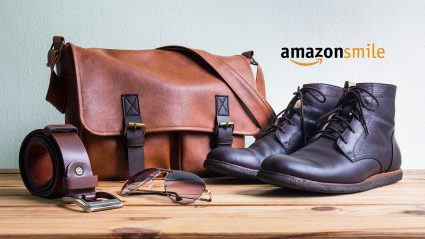 Shoes, belt and carrying bag sitting on tabletop with AmazonSmile logo