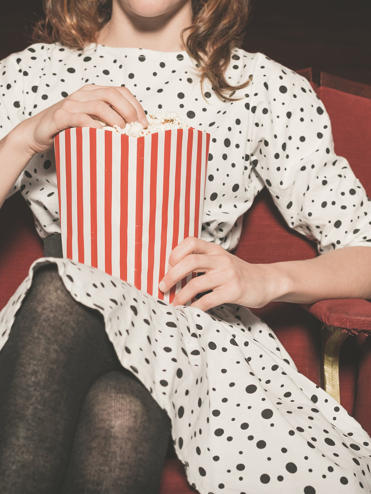 Person eating popcorn