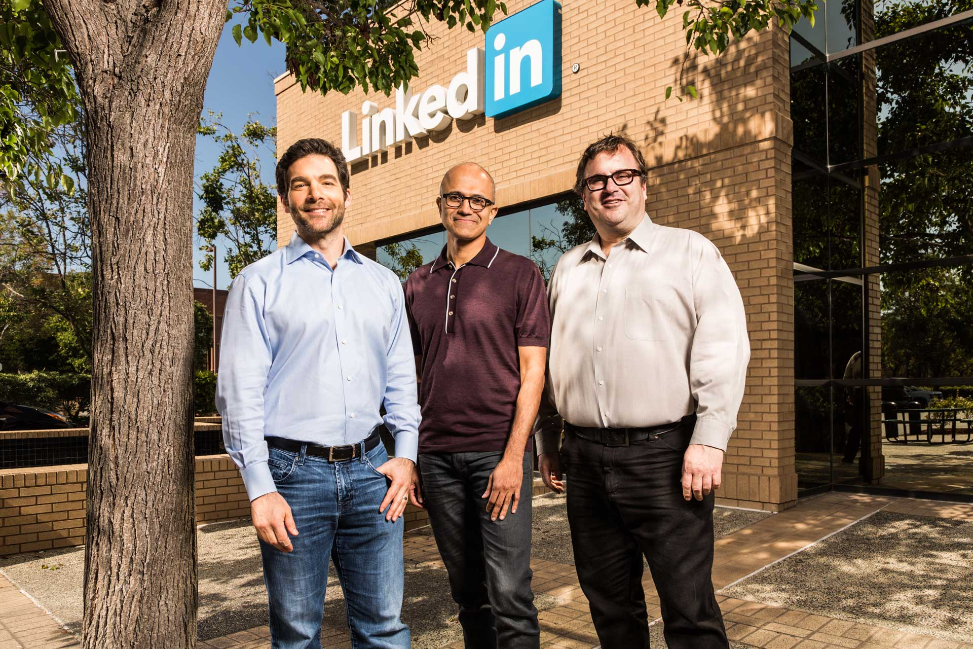 men standing in front of building with LinkedIn sign