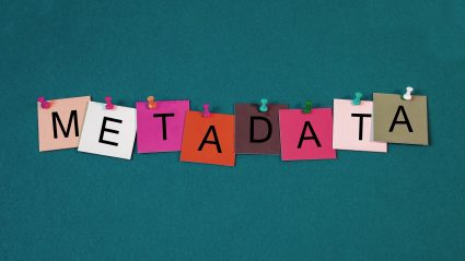 Paper notes with letters that spell SEO Metadata