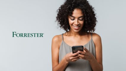 Woman looking at phone with Forrester logo