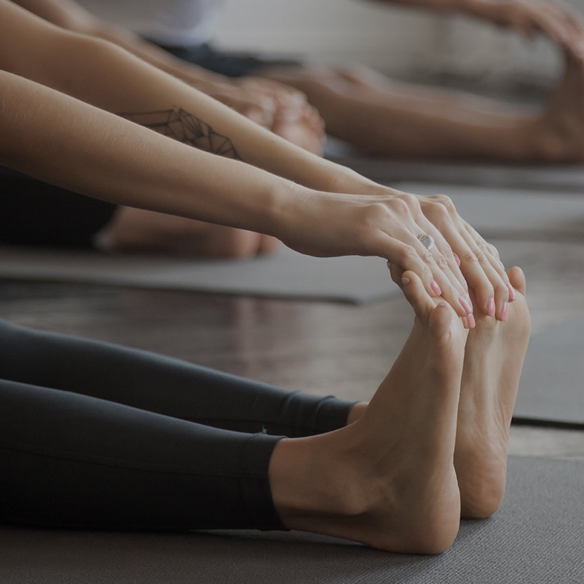 Person touching toes in yoga pose