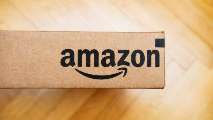 amazon logo on box on wood floor