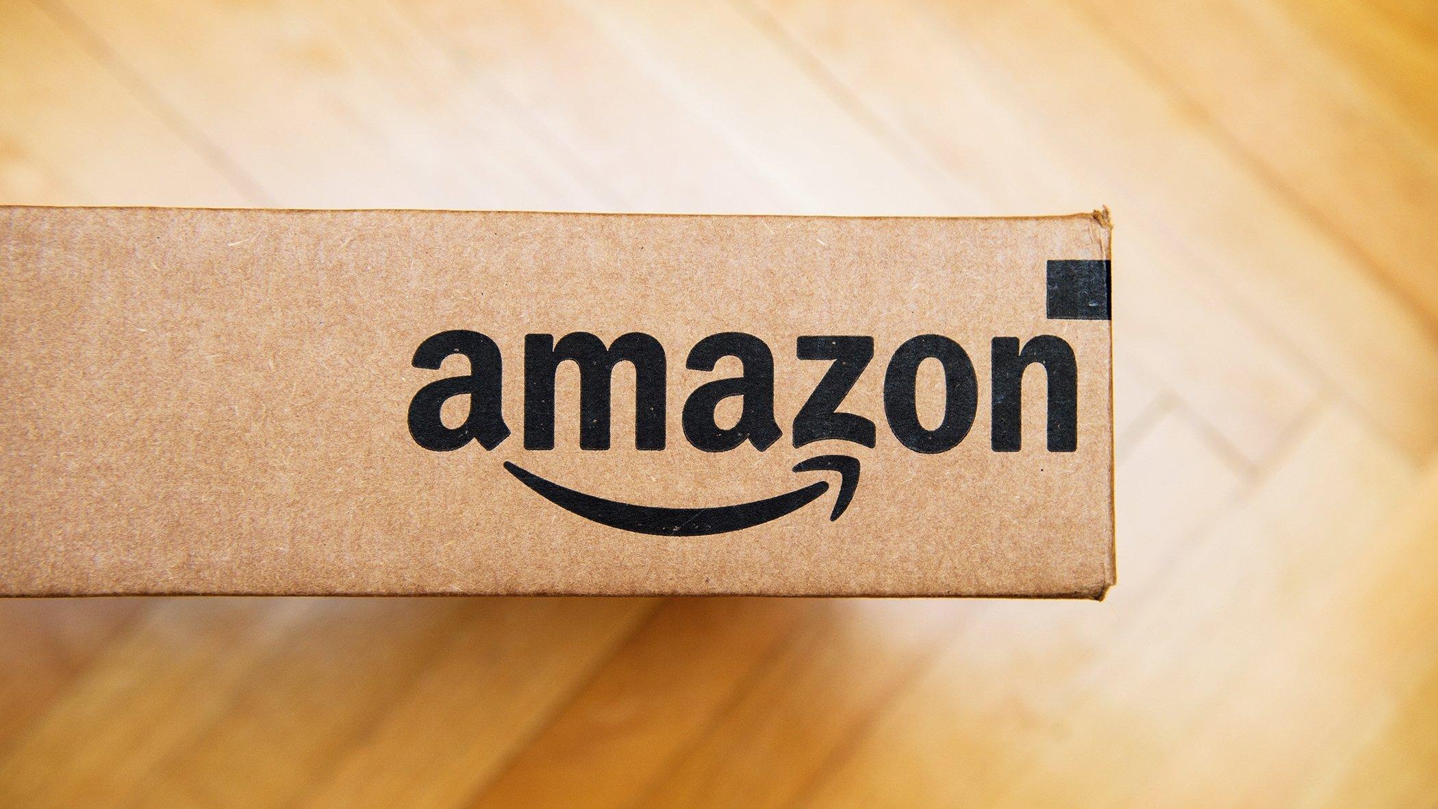 amazon logo on box on wood floor