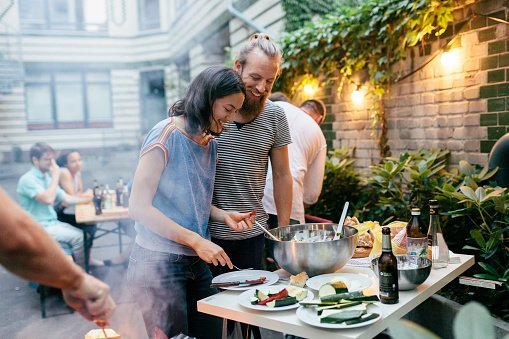 Residential community having dinner outside together
