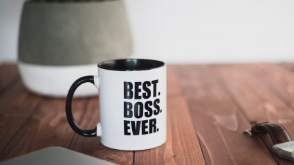 """Mug sitting on desk which says """"Best Boss Ever"""""""