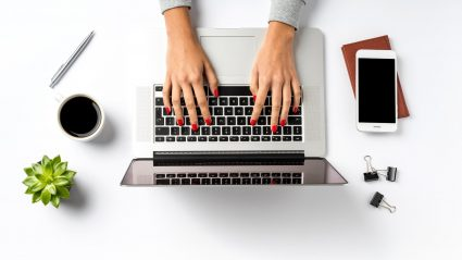 Woman marketer typing on laptop