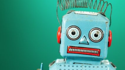 vintage robot on green background