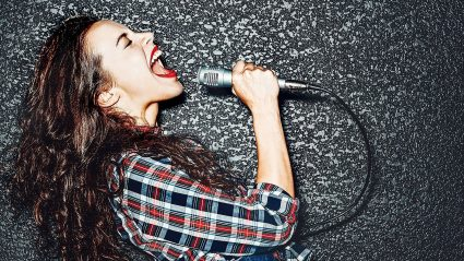 woman singing passionately into a microphone