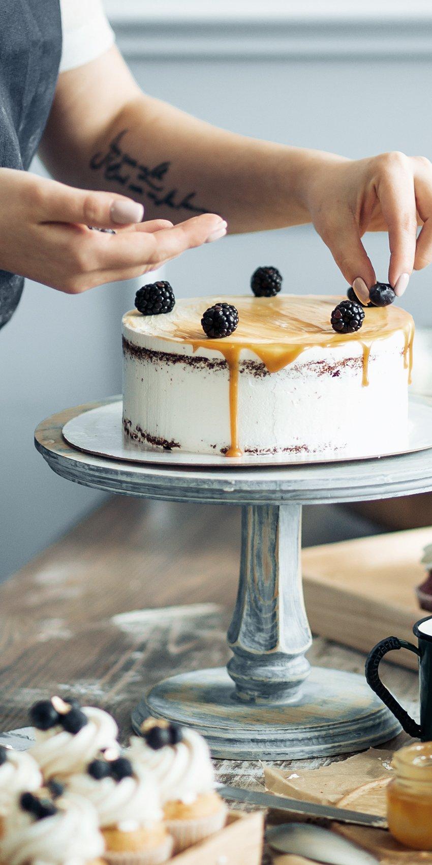 Baker decorating cake