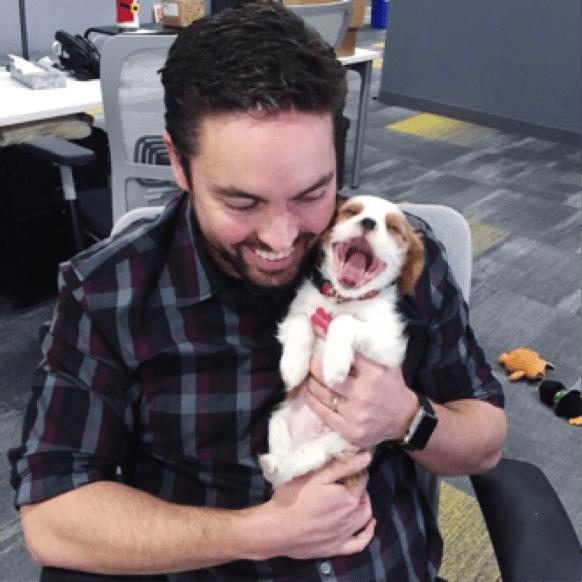 mike mothner holding puppy charlie mothner