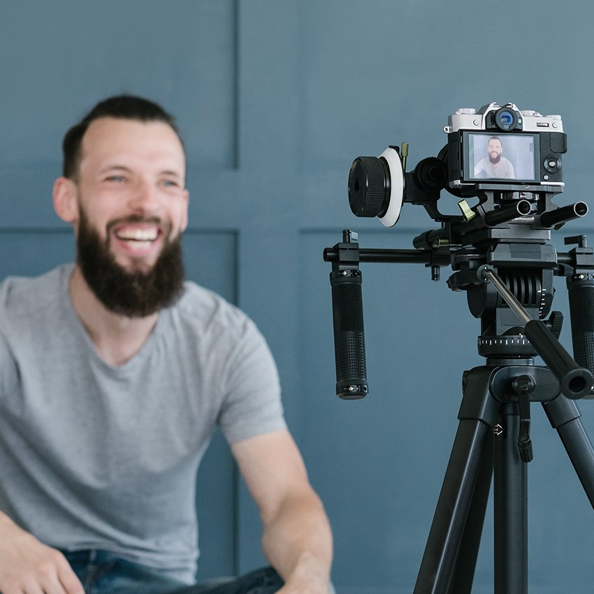 Male influencer in front of a camera