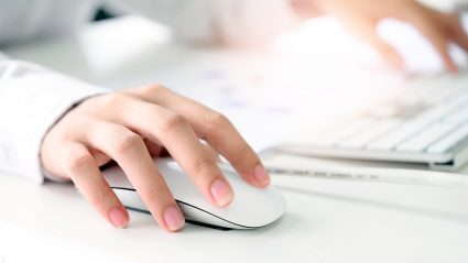 close up on woman hand clicking ppc