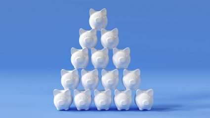 pyramid of white piggy banks on blue background