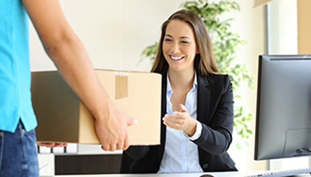 Woman receiving a package at work