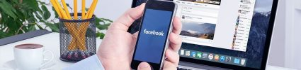 facebook marketing partner on phone and facebook platform on computer