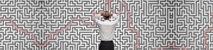Man staring at confusing maze