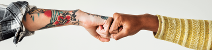 Two fists coming together to show connecting cultures