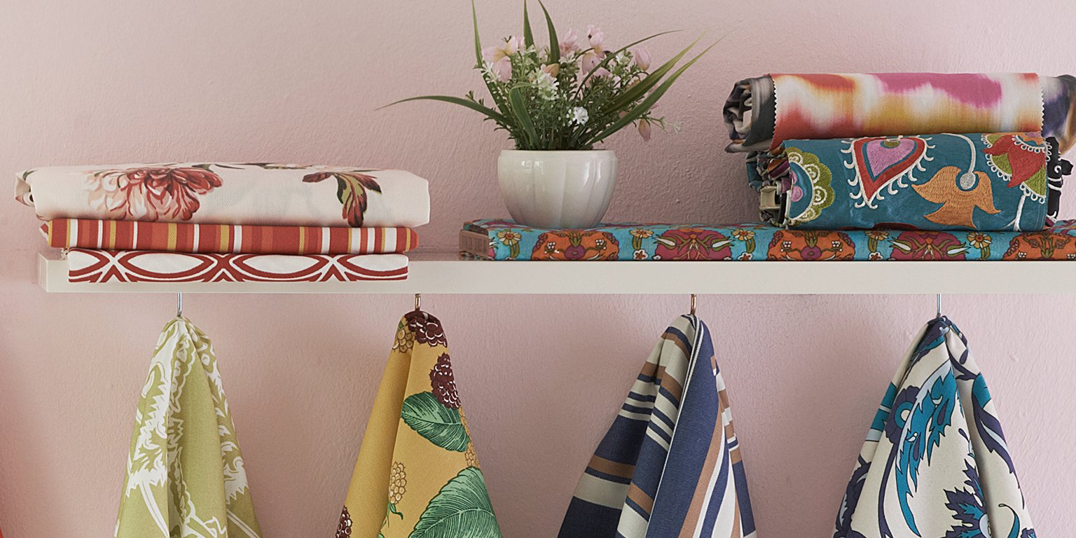 Scarves hanging from shelf