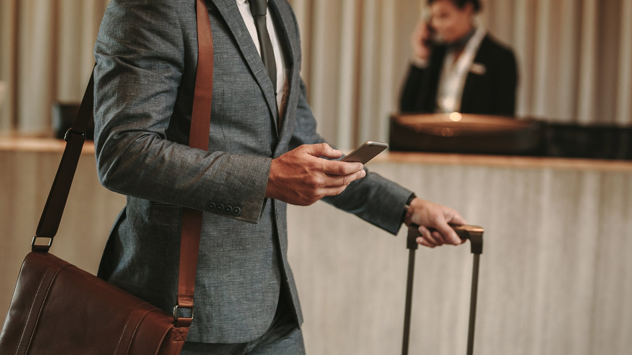 man holding phone at hotel