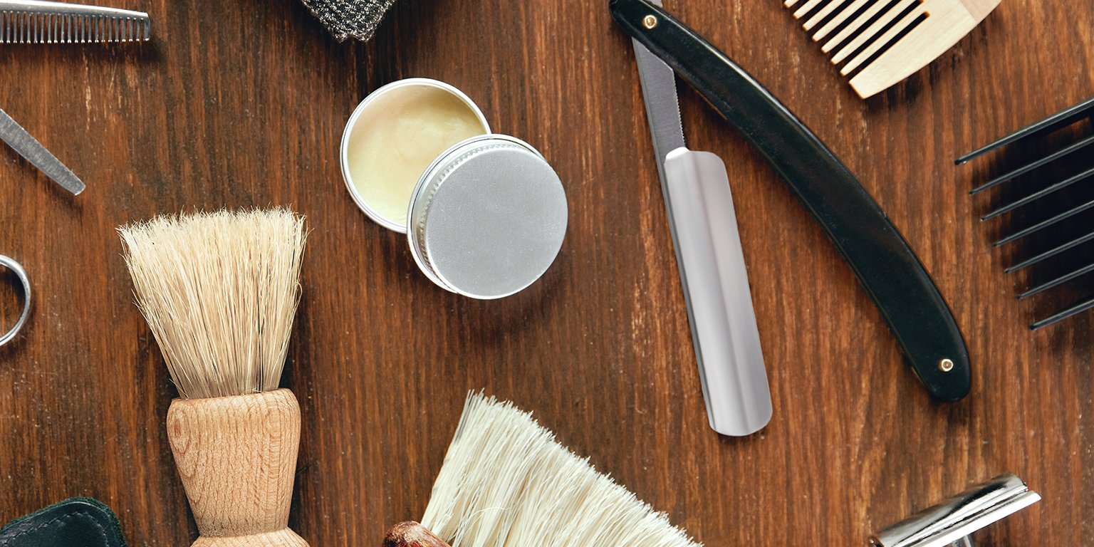 mens grooming tools on wood background