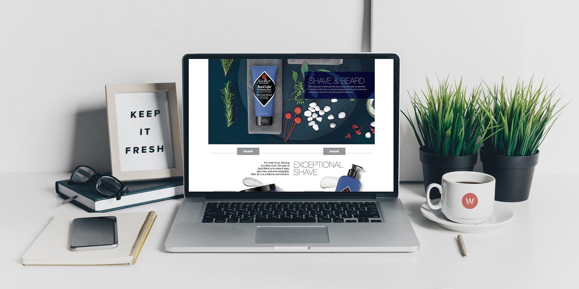 desk with jack black website up and wpromote coffee mug