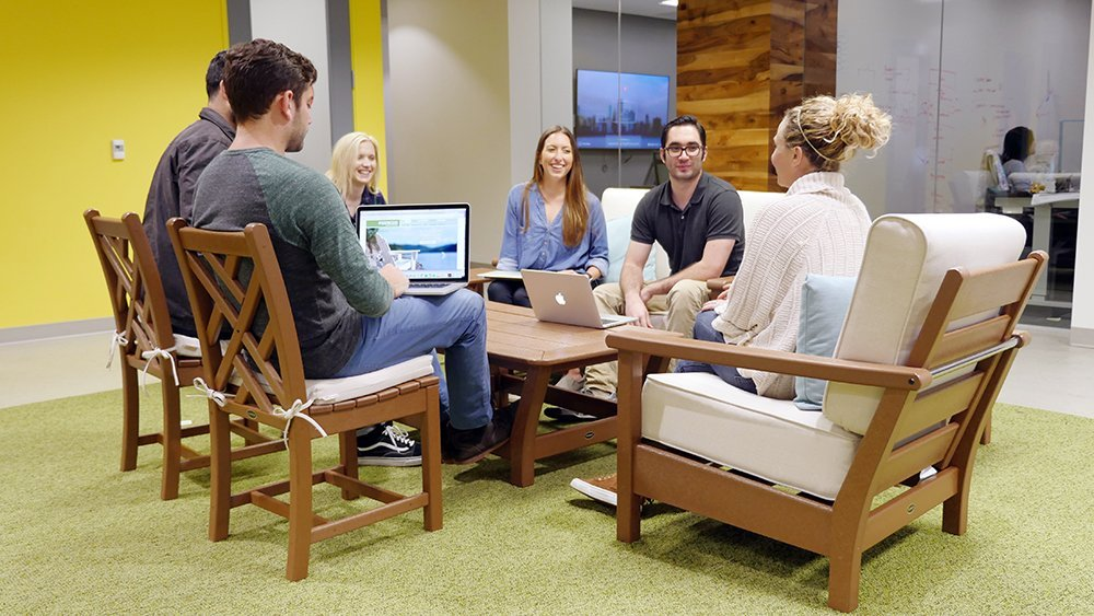 wpromote employees enjoying new POLYWOOD furniture in office