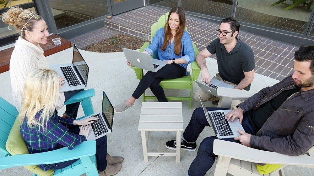 wpromote employees enjoying polywood furniture outside