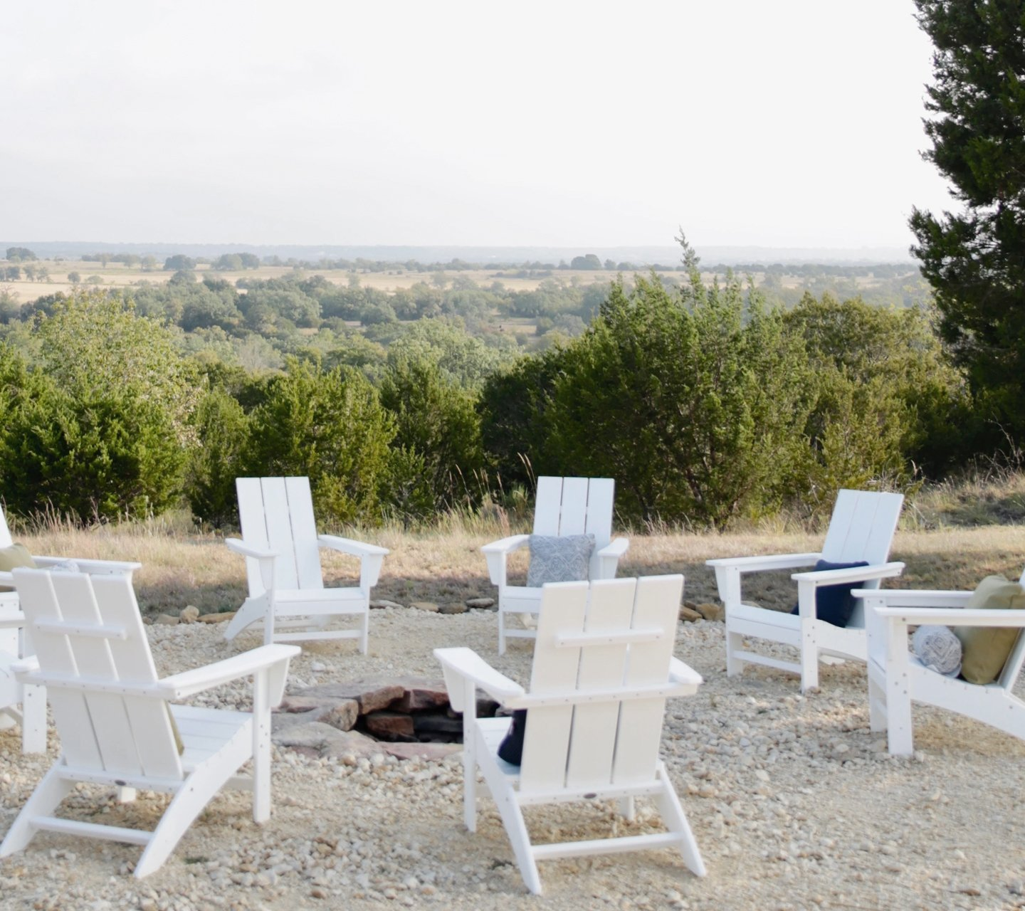 whiter polywood chairs in circle outdoors