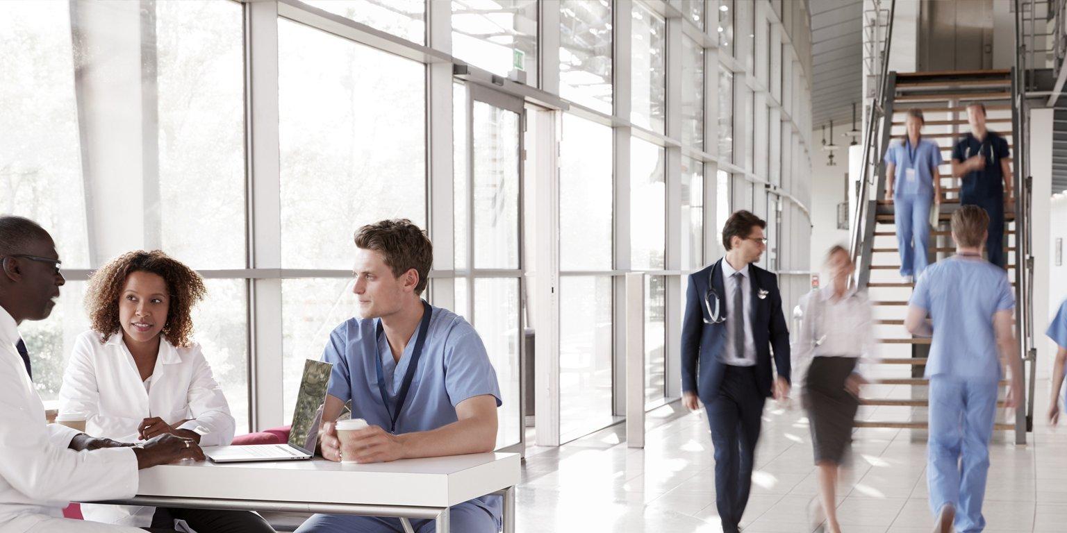 healthcare workers walking in hospital