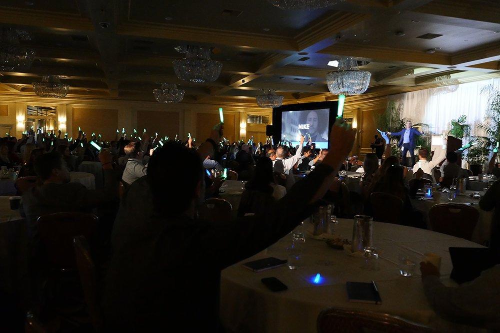 challenger summit presentation with glow sticks
