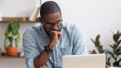 man looking disappointed staring at computer