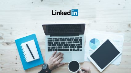 Person sitting at computer with LinkedIn logo