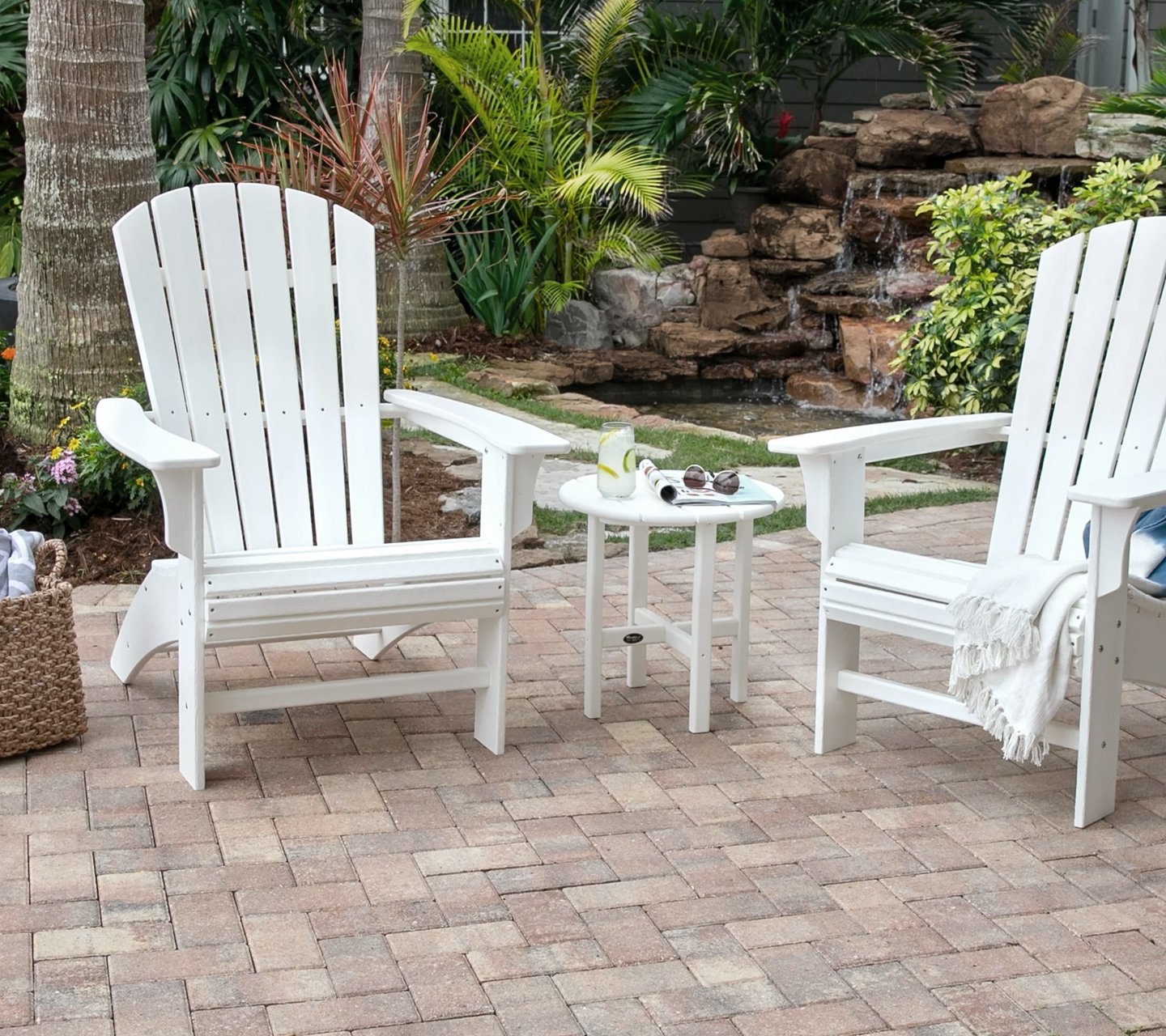 two treex white chairs on patio