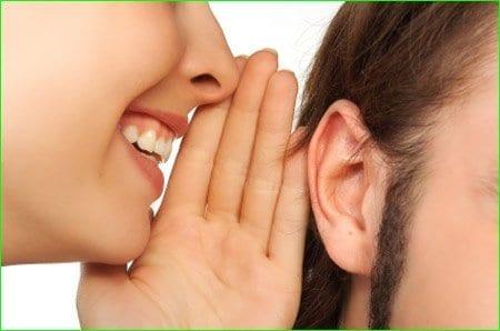 whispering in ear