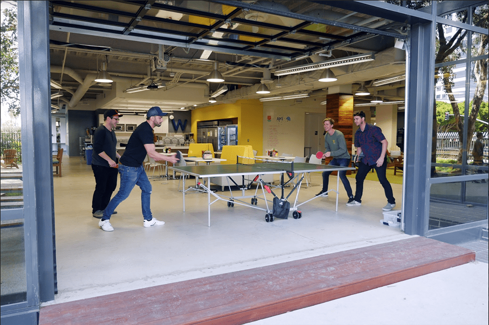 People playing ping pong at Wpromote.