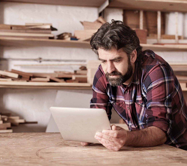 Furniture maker on laptop