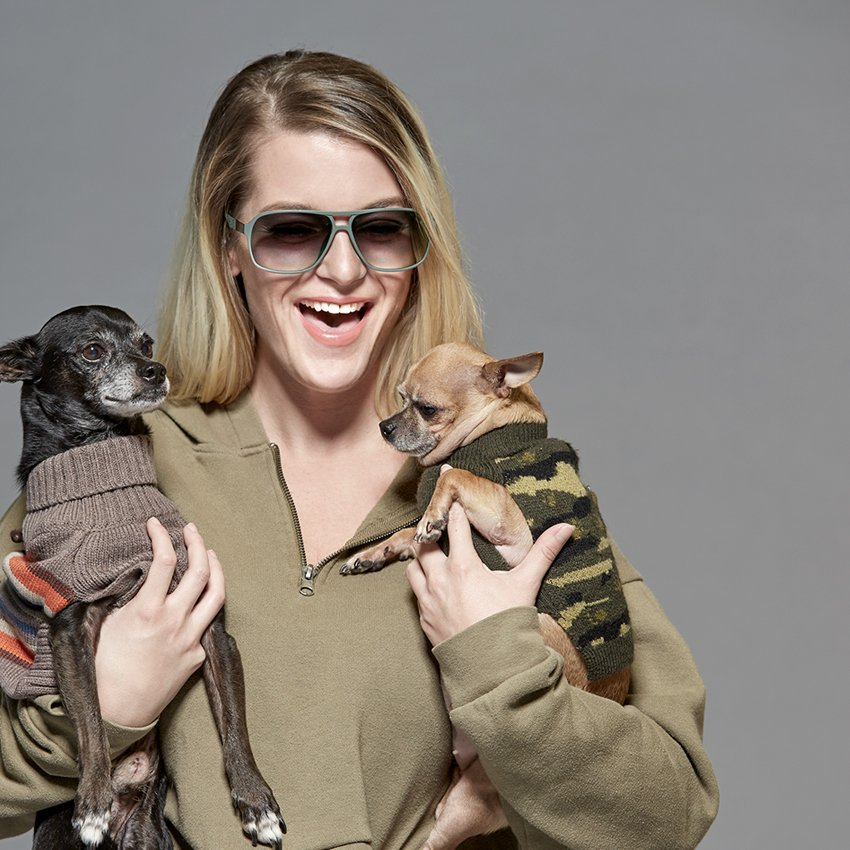 Wpromoter wearing Zenni glasses holding two dogs