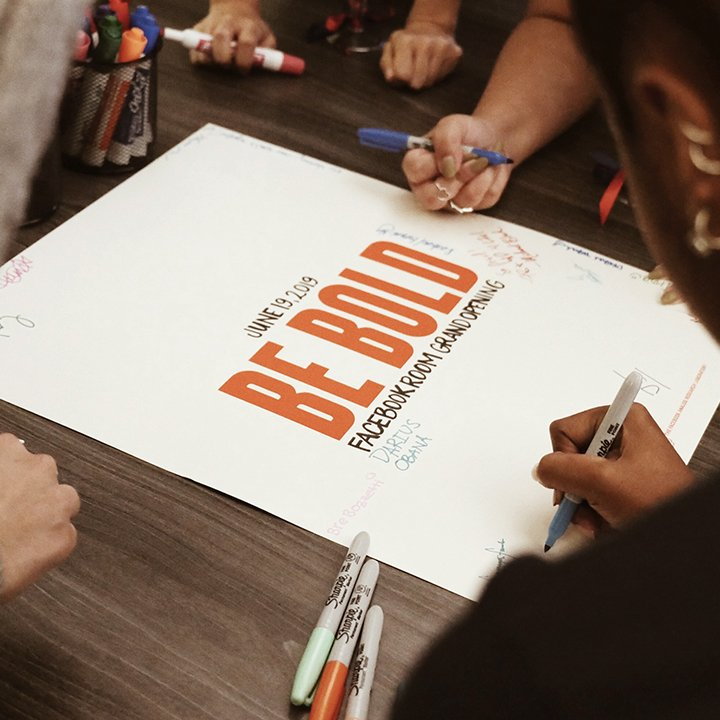 Writing on poster that says Be Bold
