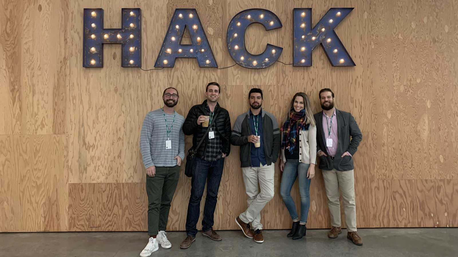 Group standing in front of HACK sign