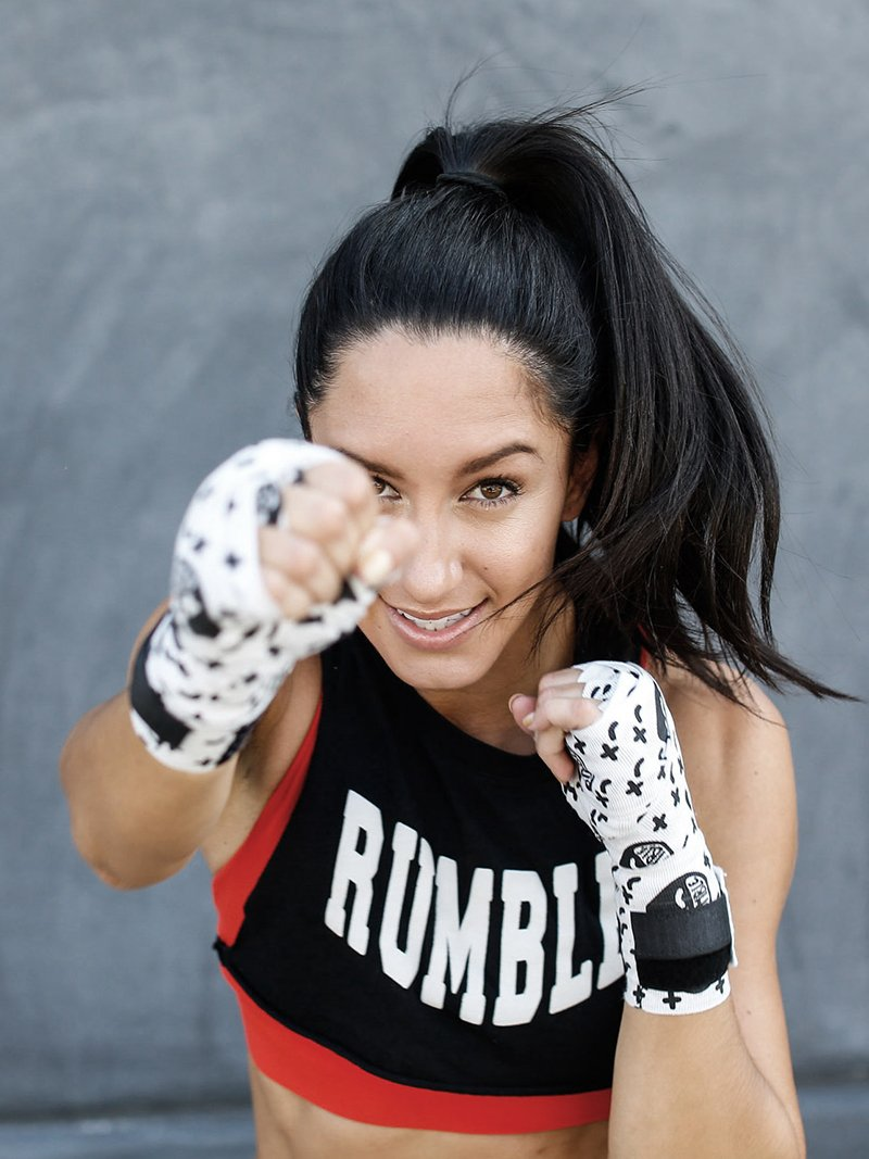 Woman with Rumble boxing shirt and gloves